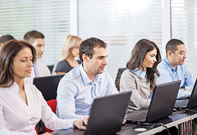 Employees taking interactive courses